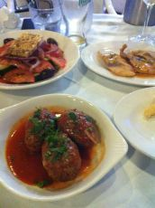 Meatballs, tomato salad and fish