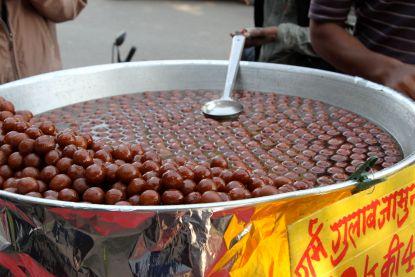 Gulab Jamuns soaking in sugar syrup