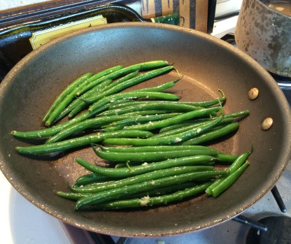 Green beans cooking in garlicky goodness