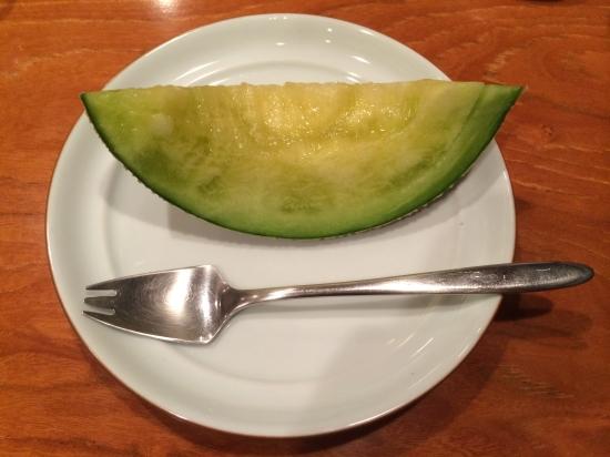 Musk melon with a spork